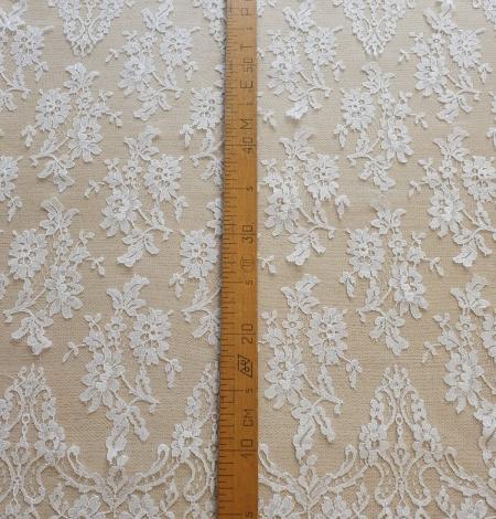 White chantilly lace fabric . Photo 6