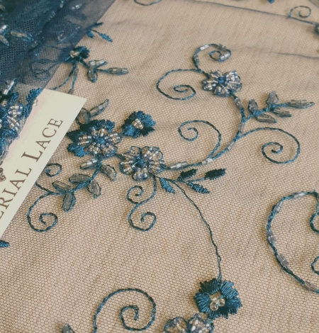 Turquoise embroidery lace fabric. Photo 4