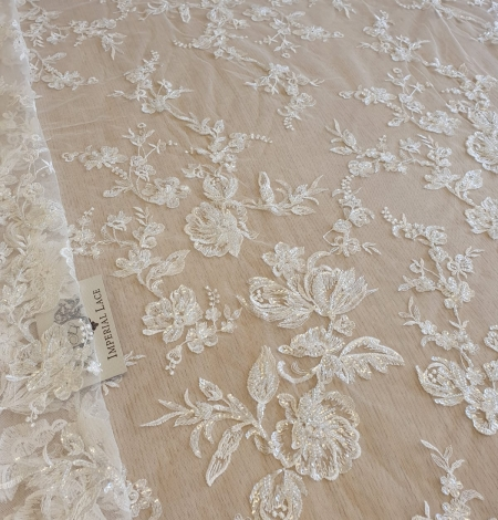 Ivory beaded floral lace fabric. Photo 1