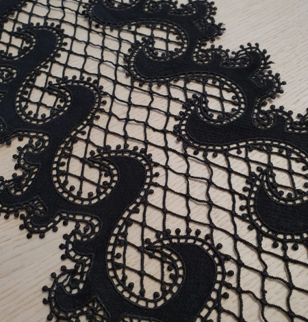 Black 100% polyester wave effect guipure lace trimming. Photo 3
