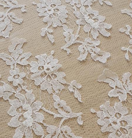 White chantilly lace fabric . Photo 4