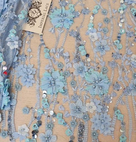 Blue 3D floral organic pattern on tulle fabric. Photo 1