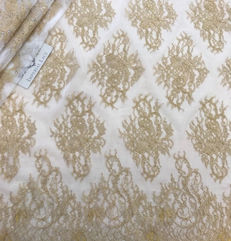 Gold lace fabric. Photo 1