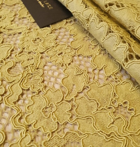 Pistachio green guipure lace fabric. Photo 5