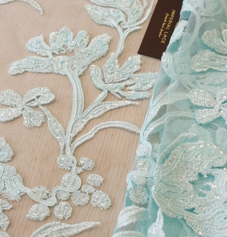 Blue floral pattern sequin embroidery on tulle fabric. Photo 1