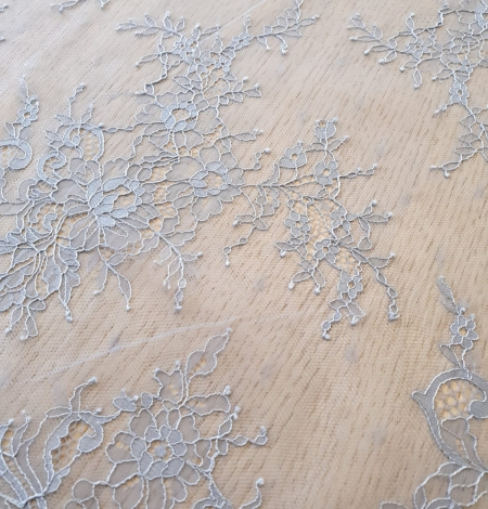 light blue floral pattern chantilly lace fabric. Photo 2
