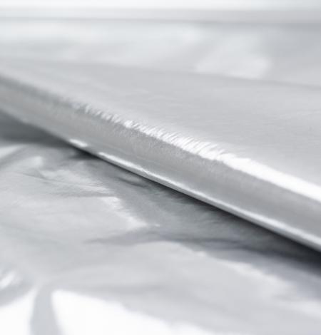 Silver color shiny rain coat fabric. Photo 3