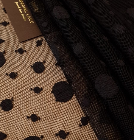 Black 100% polyester abstract circle pattern tulle fabric. Photo 4