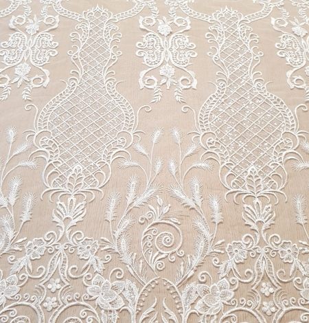 Ivory embroidery on tulle fabric. Photo 4