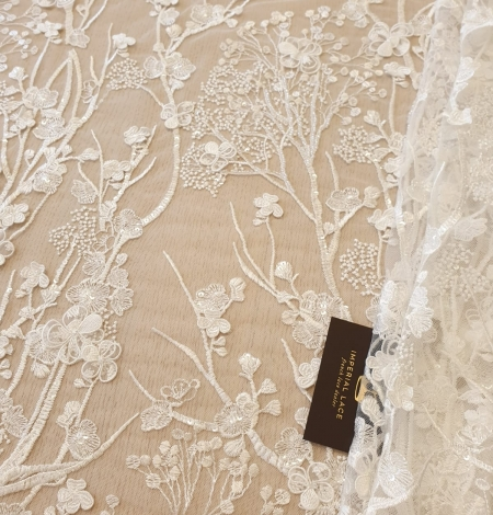 Ivory floral embroidery on tulle fabric. Photo 1