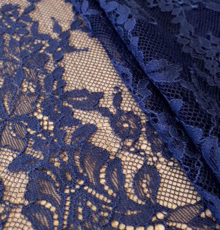 Blue 100% polyester floral chantilly lace fabric. Photo 2