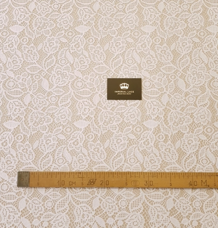 Snow white guipure floral pattern lace fabric. Photo 7
