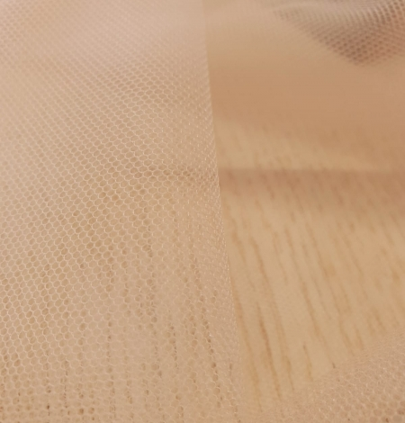 Nude 100% polyamide clear invisible tulle fabric. Photo 9