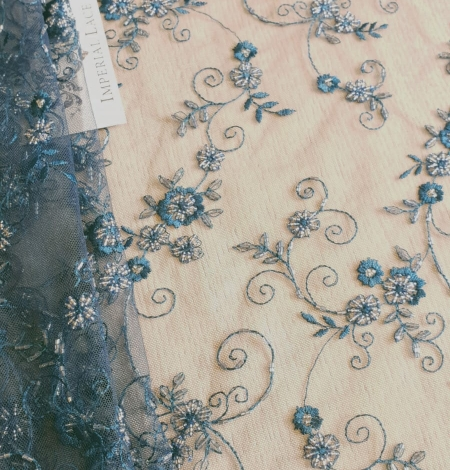 Turquoise embroidery lace fabric. Photo 1