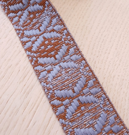 Light greyish blue with brown geometric ribbon application. Photo 6