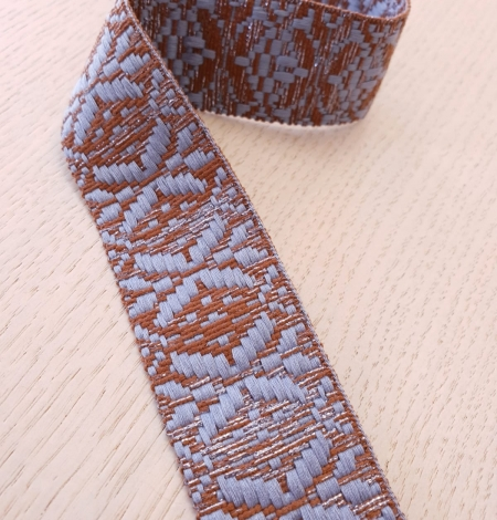 Light greyish blue with brown geometric ribbon application. Photo 5