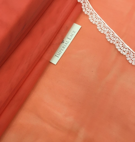 Orange tulle fabric. Photo 2