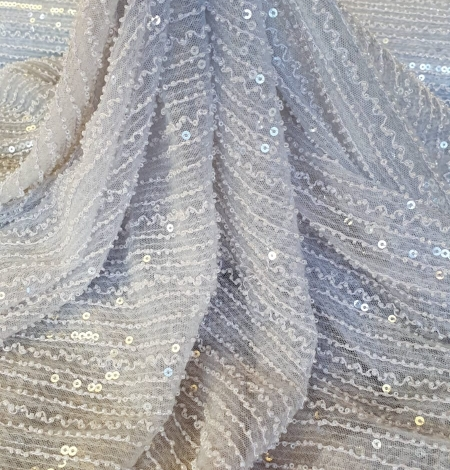 Light blue tulle with sequins and beads fabric. Photo 5