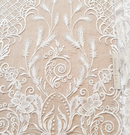 Ivory embroidery on tulle fabric. Photo 1