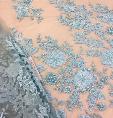 Light greenish blue floral lace fabric. Photo 1