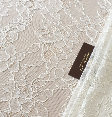 Ivory chantilly lace with thick thread lace fabric . Photo 2