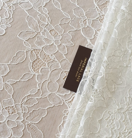 Ivory chantilly lace with thick thread lace fabric . Photo 1
