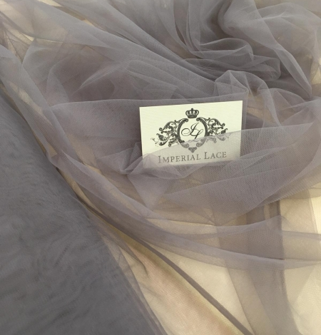 Soft grey tulle fabric with lilac shade. Photo 1