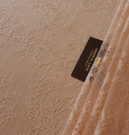 Nude 100% polyester floral chantilly lace fabric. Photo 4