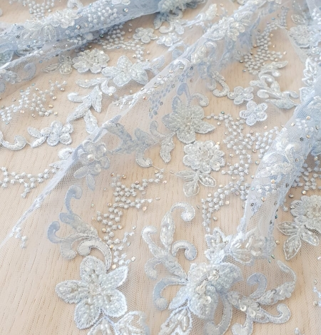 Light blue beaded embroidery on tulle fabric. Photo 2