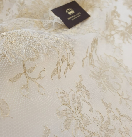 Ivory with gold thread viscose lace fabric. Photo 1