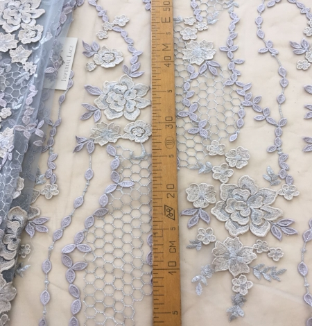 Greyish blue embroidery on tulle fabric. Photo 8