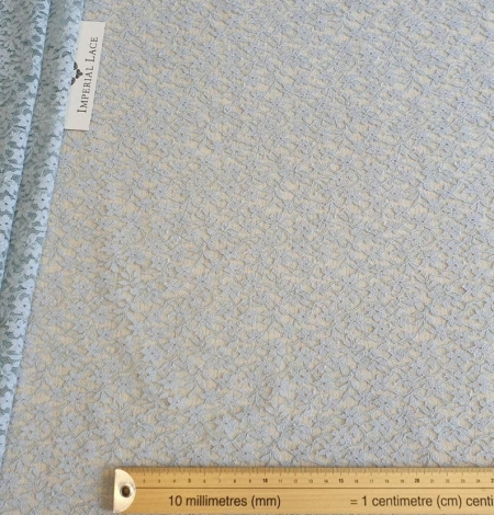 Grey with bluish green base lace fabric. Photo 7