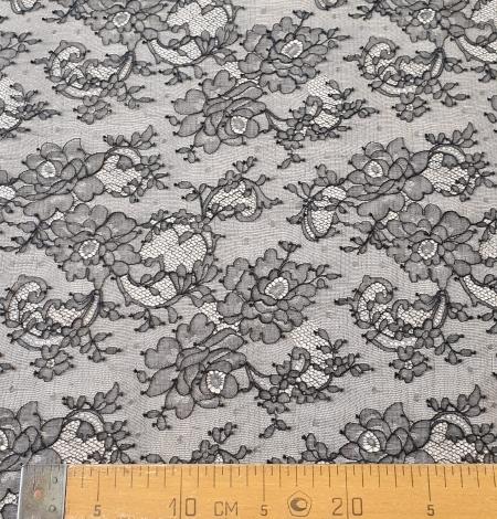 Black elastic chantilly lace fabric. Photo 8