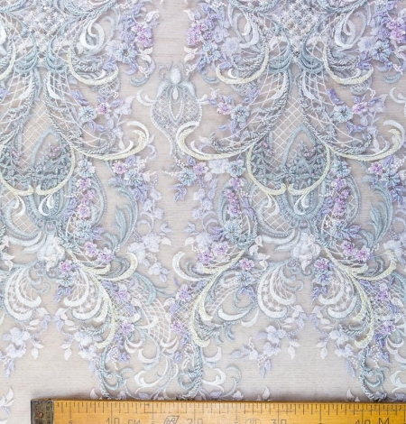 Greenish with purple embroidery on tulle fabric . Photo 7