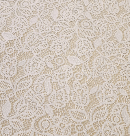 Snow white guipure floral pattern lace fabric. Photo 2