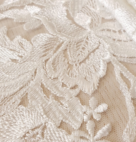 Ivory 100% polyester floral pattern embroidery lace fabric. Photo 4