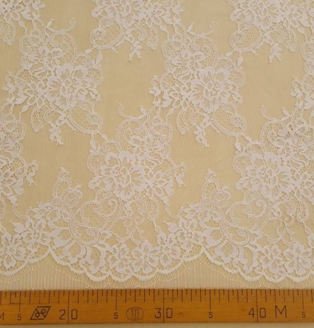 White with lilac shade chantilly lace fabric. Photo 5