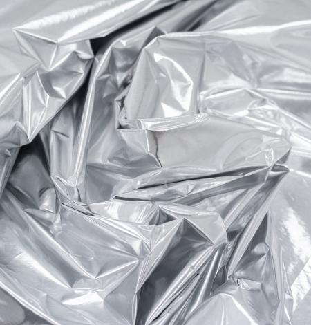 Silver color shiny rain coat fabric. Photo 9