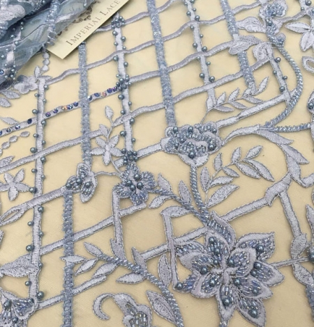 Blue beaded embroidery lace fabric. Photo 1