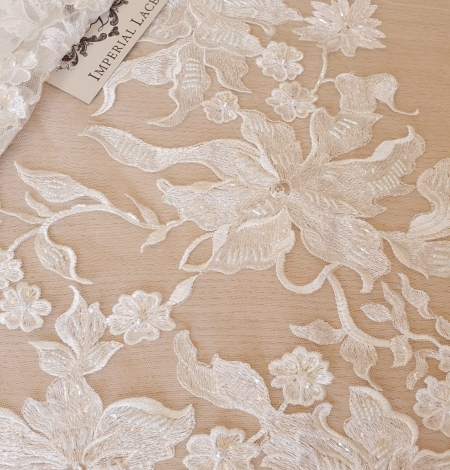 Ivory beaded floral pattern embroidery on tulle fabric. Photo 1