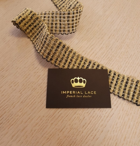 Gold and black elastic ribbon application. Photo 2