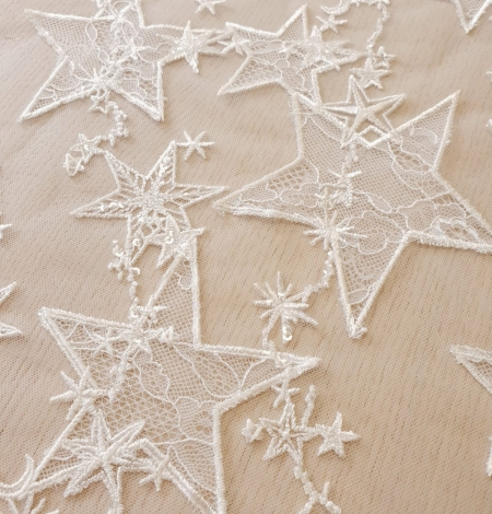 Ivory 100% polyester star pattern embroidery on tulle with beads and chantilly details lace fabric. Photo 2