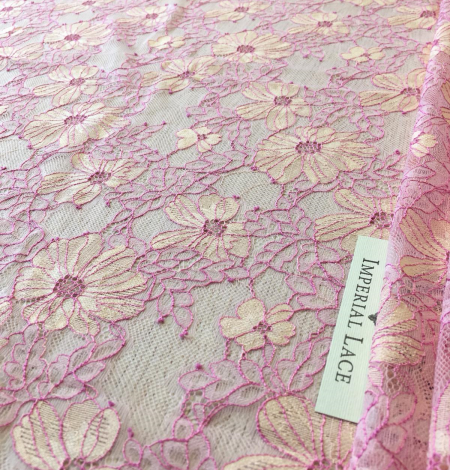 Pink with light yellow lace fabric. Photo 1