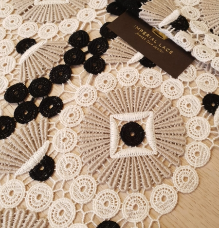 Beige with black and white macrame lace fabric. Photo 1