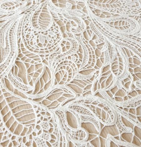 Ivory floral pattern macrame lace fabric . Photo 2