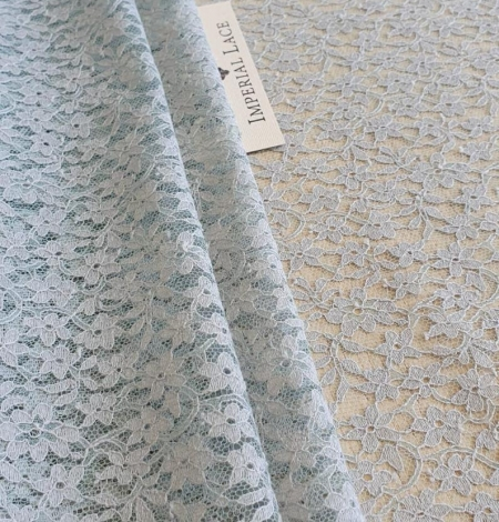 Grey with bluish green base lace fabric. Photo 1