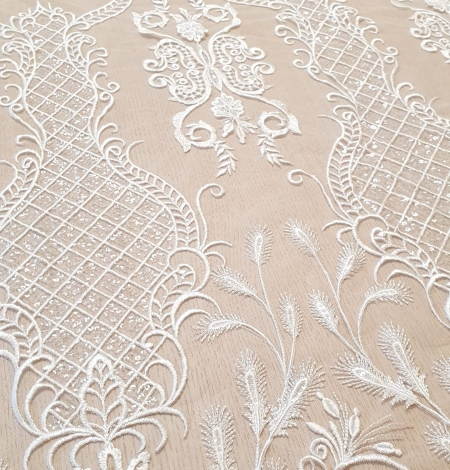 Ivory embroidery on tulle fabric. Photo 3