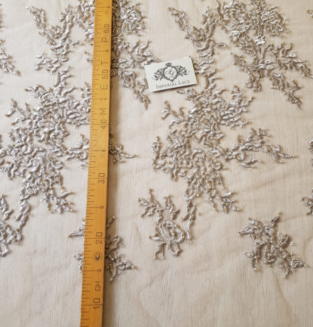 Beige embroidery on tulle fabric . Photo 10