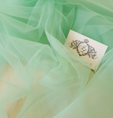 Mint green tulle fabric. Photo 3