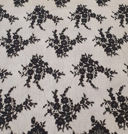 Black floral chantilly viscose lace fabric. Photo 9